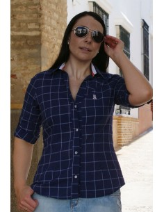 Woman blue shirt with details of the flag of Spain.