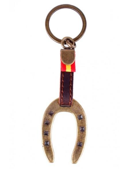 Llavero de cuero con herradura de bronce y bandera de España.